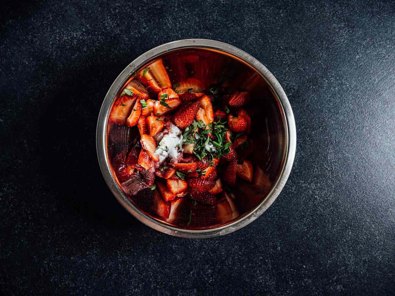 strawberries, mint, sugar, thai basil in a bowl