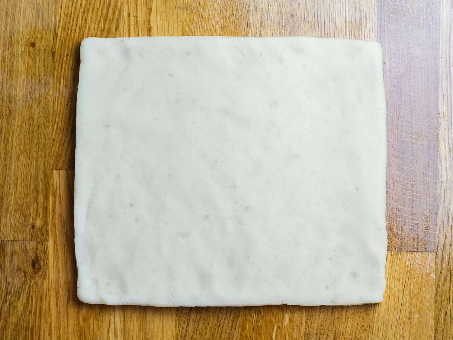 Squared off shaped dough on a work surface