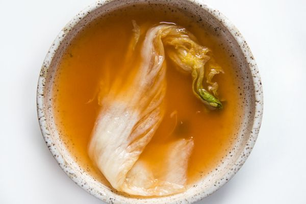 Kimchi in a bowl with broth.