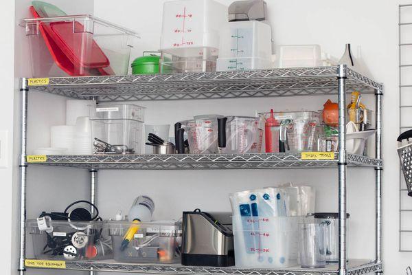 a close up of a metro rack shelving unit filled with kitchen equipment from the Serious Eats test kitchen