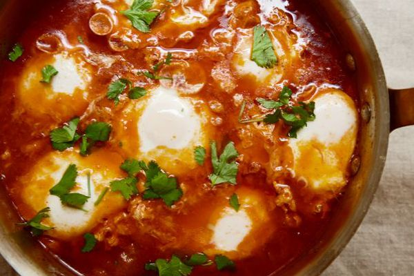 Moroccan Merguez Ragout with Poached Eggs in a skillet