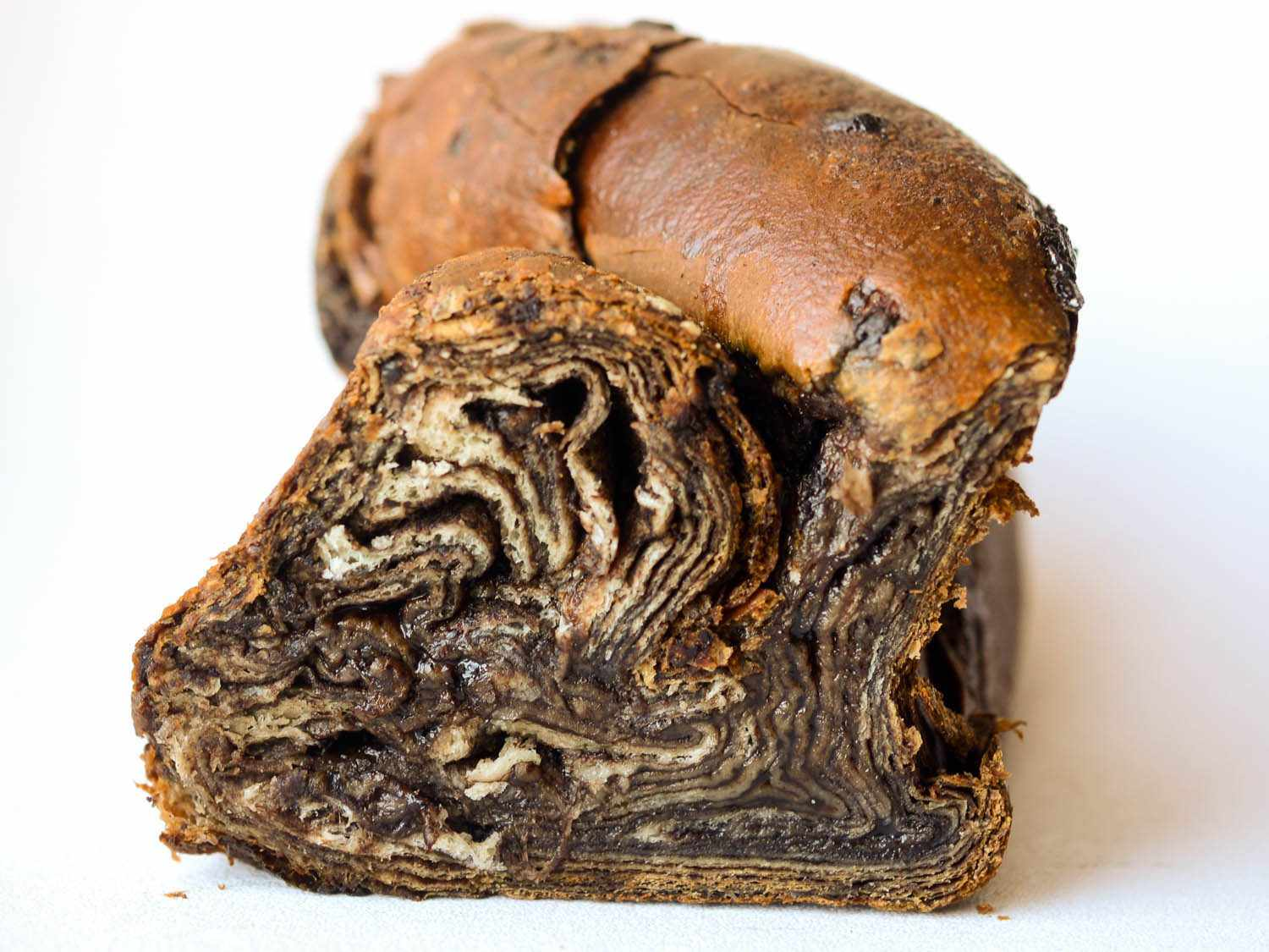 Photo of the cross section of a chocolate babka.