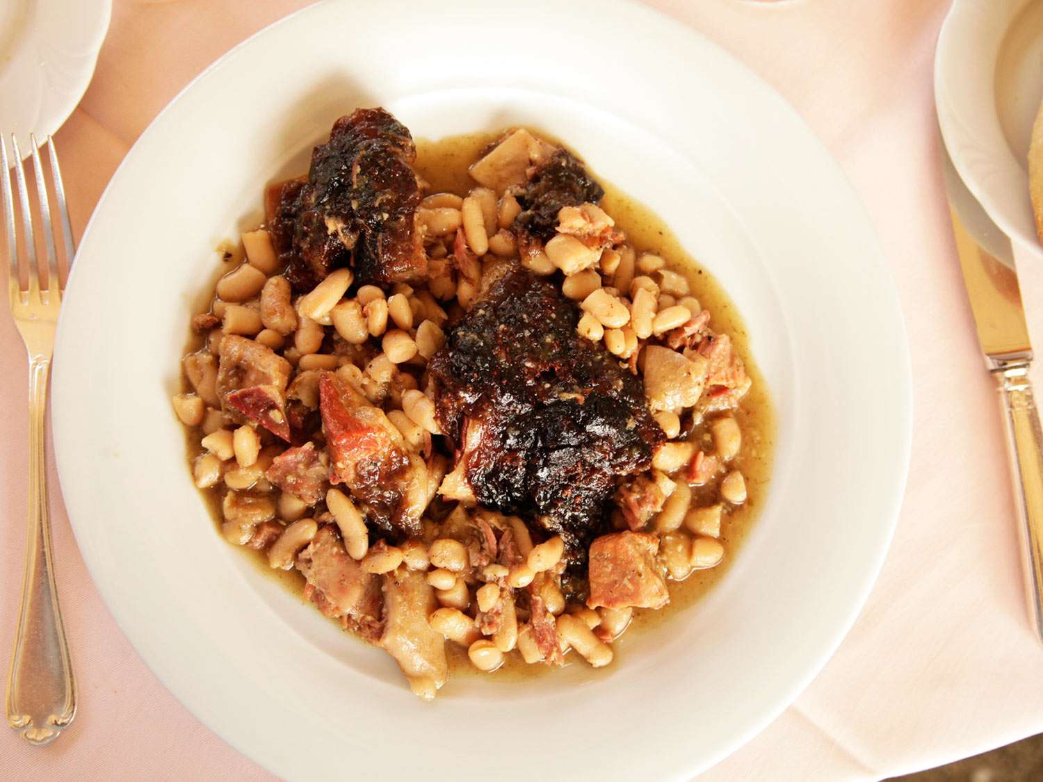 Traditional cassoulet served on a plate in Languedoc, France.