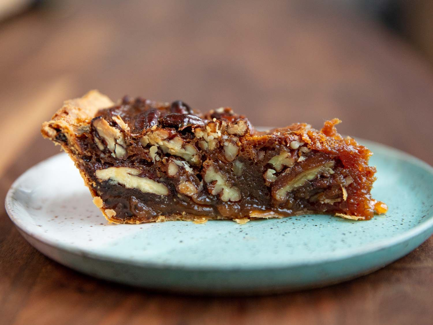 A slice of pecan pie on a plate