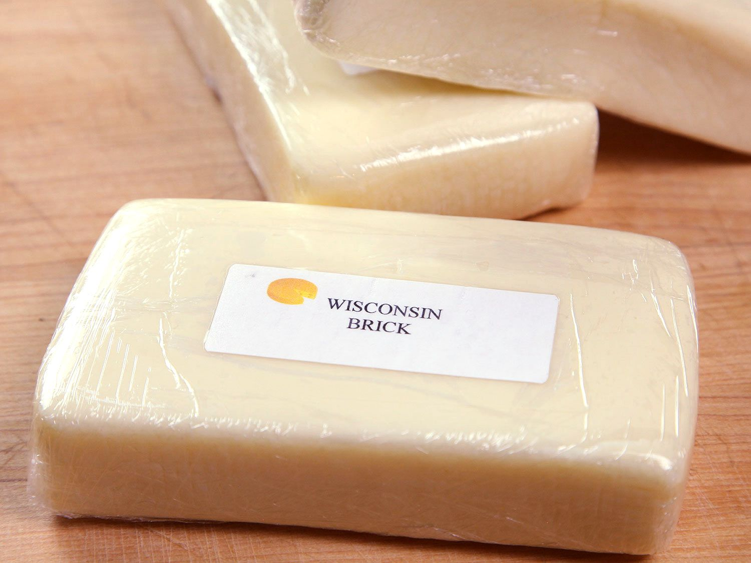 Slabs of Wisconsin Brick cheese resting on countertop
