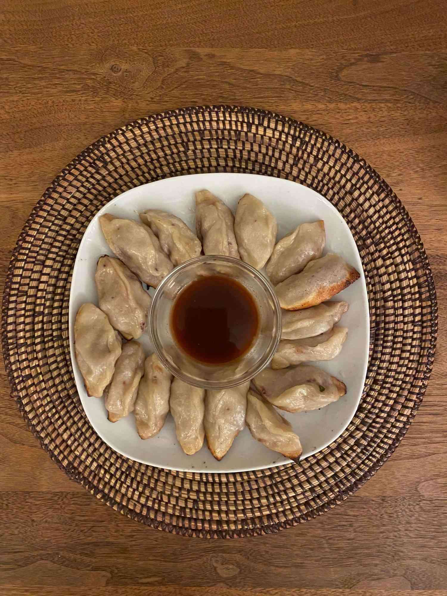 plate of pork and scallion dumplings