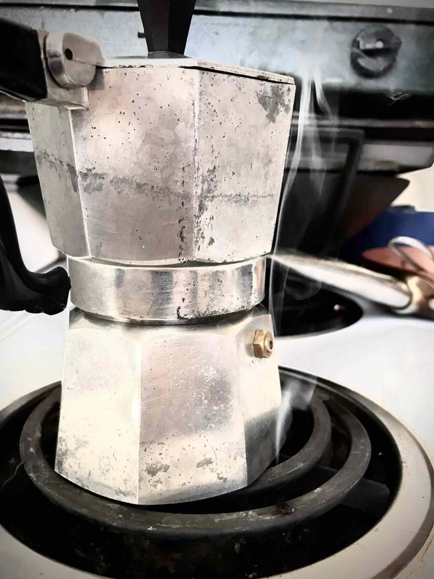 A moka pot on a burner