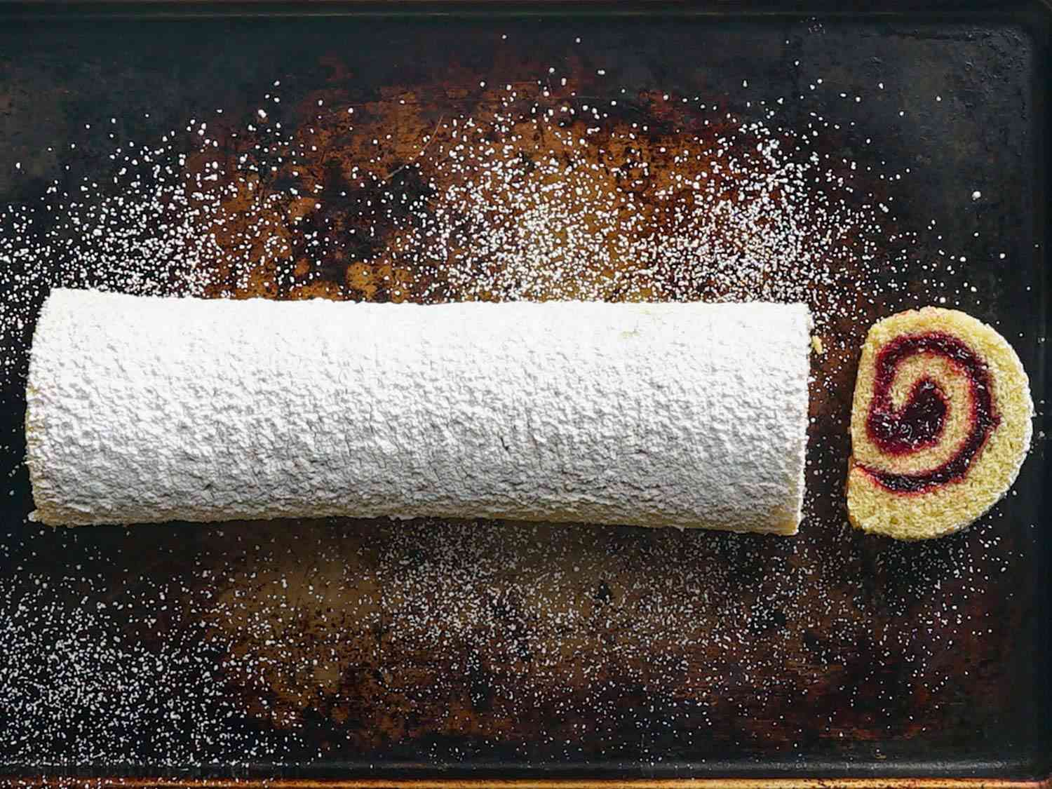 overhead shot of a sliced jelly roll dusted in powdered sugar