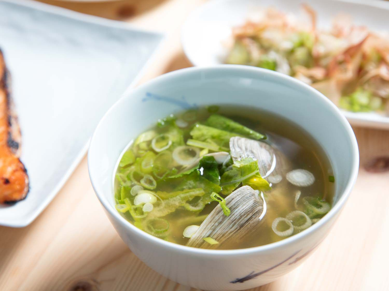 Bowl of miso soup with clams and scallions
