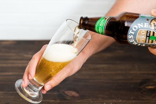Pouring a beer in a glass.