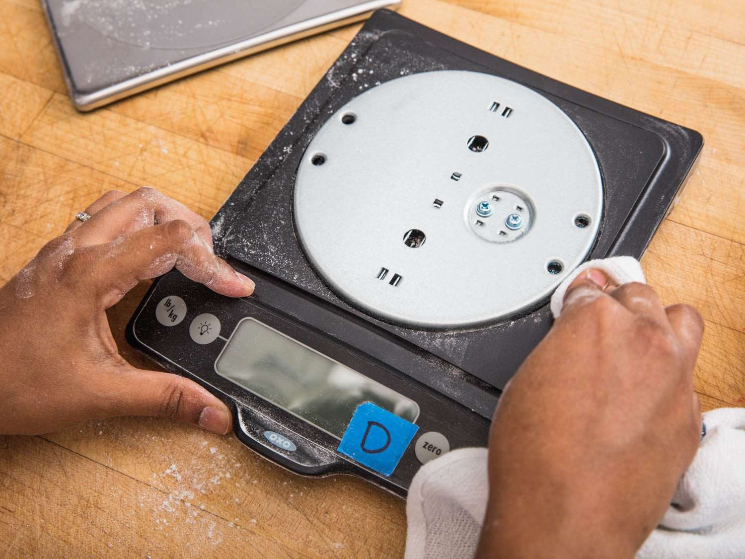 Cleaning the inside of a digital kitchen scale.