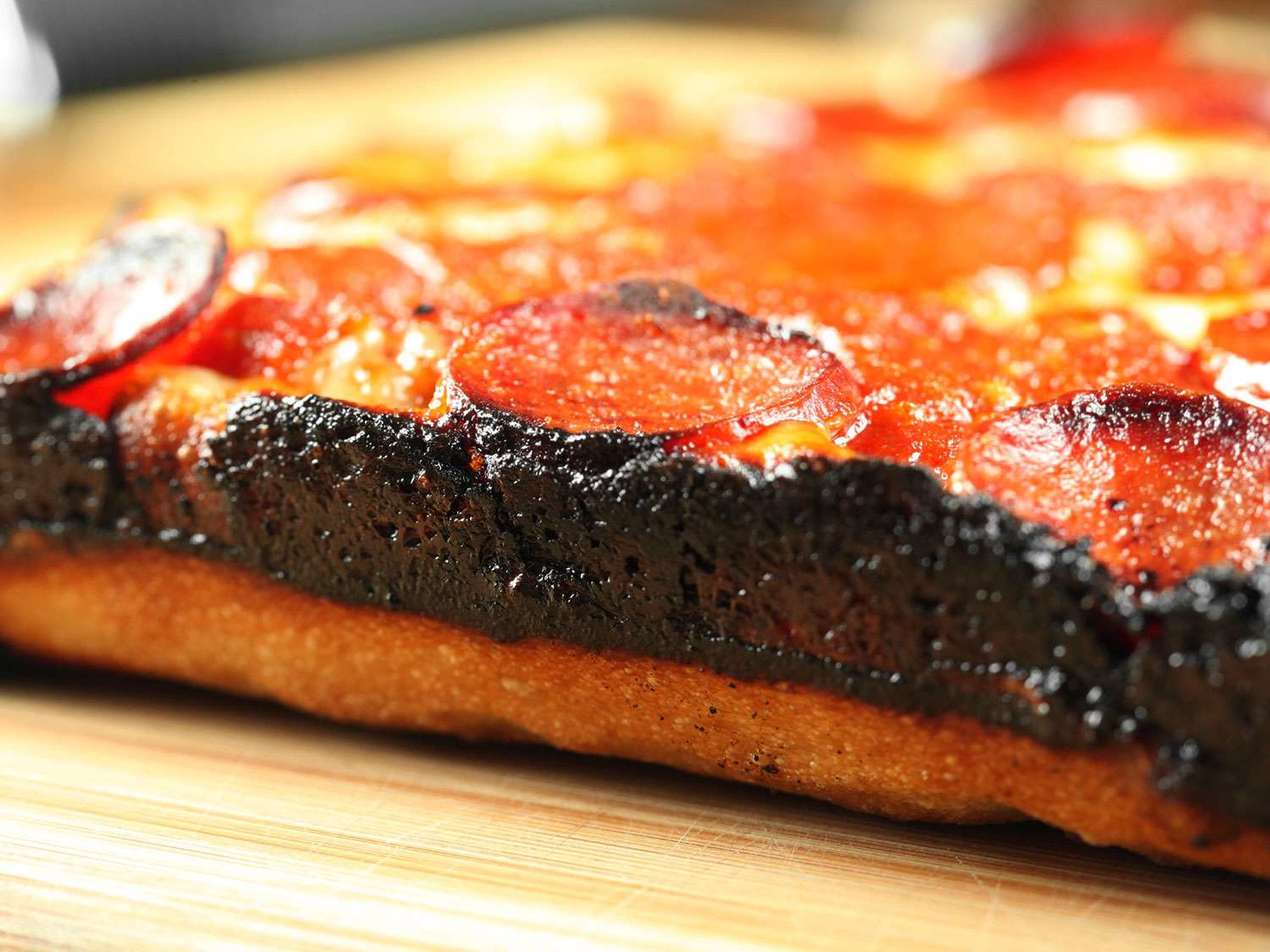 Crisp cheese cooked onto the edge of a Detroit-style pizza