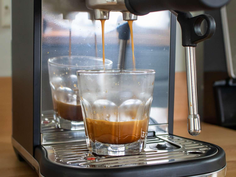 pulling a shot of espresso from the Breville Bambino Plus espresso machine