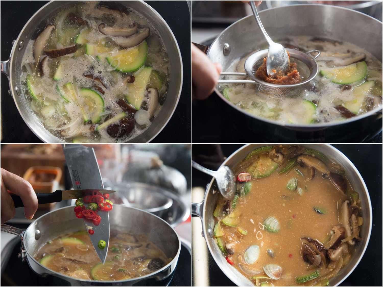 Adding doenjang and chili peppers to a pot of simmering doenjang jjigae