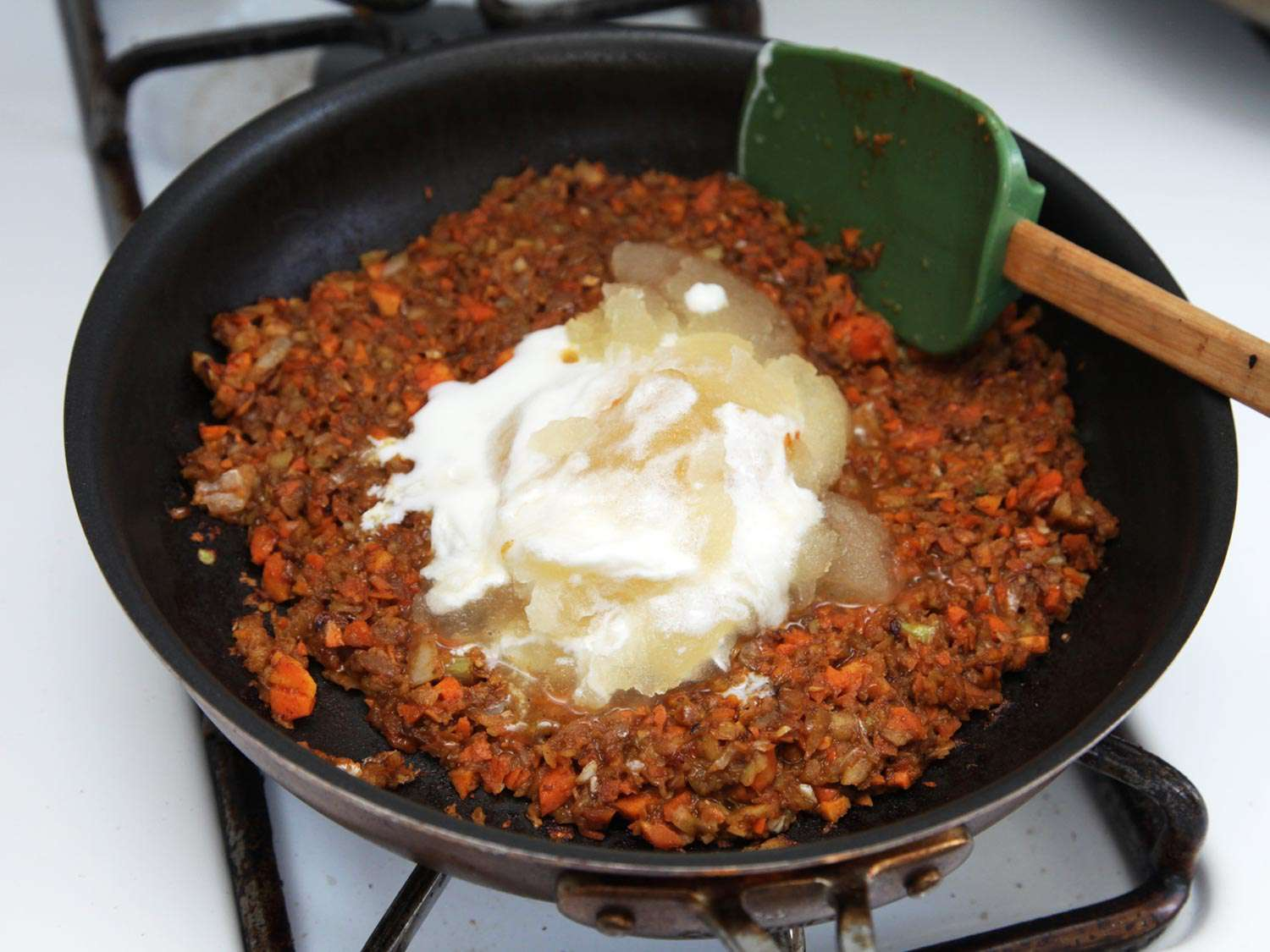 Cooked vegetables and panade in skillet