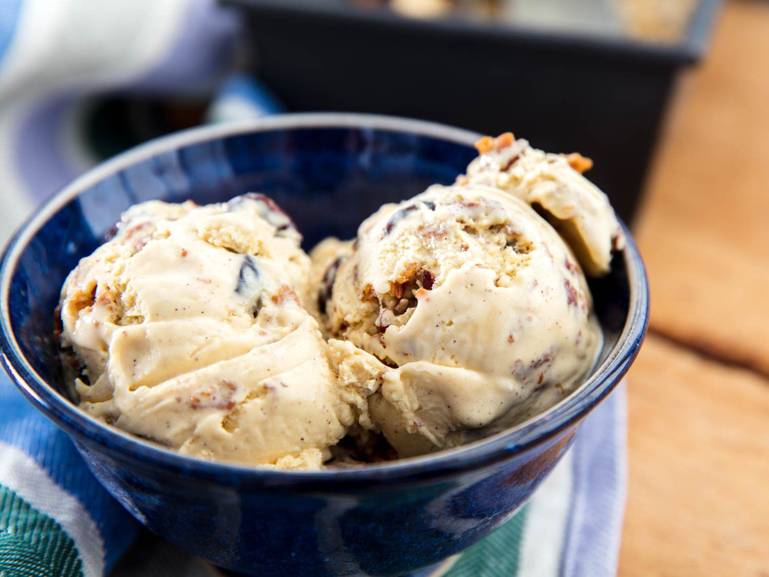 Two scoops of oatmeal cookie ice cream in a blue bowl