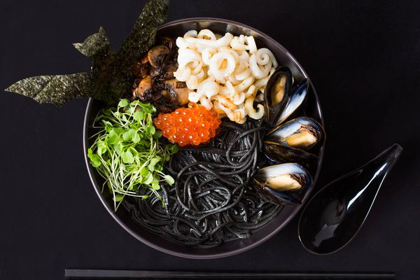 Seafood ramen with squid ink, mussels, and salmon roe
