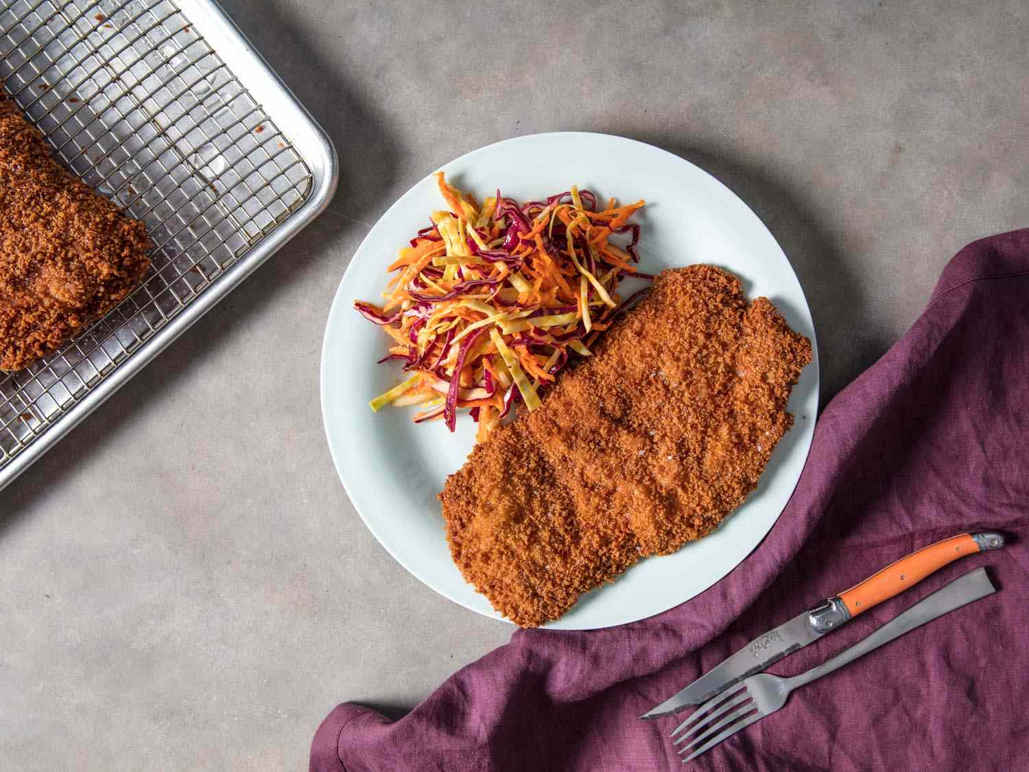 Breaded pork cutlet with slaw overhead view