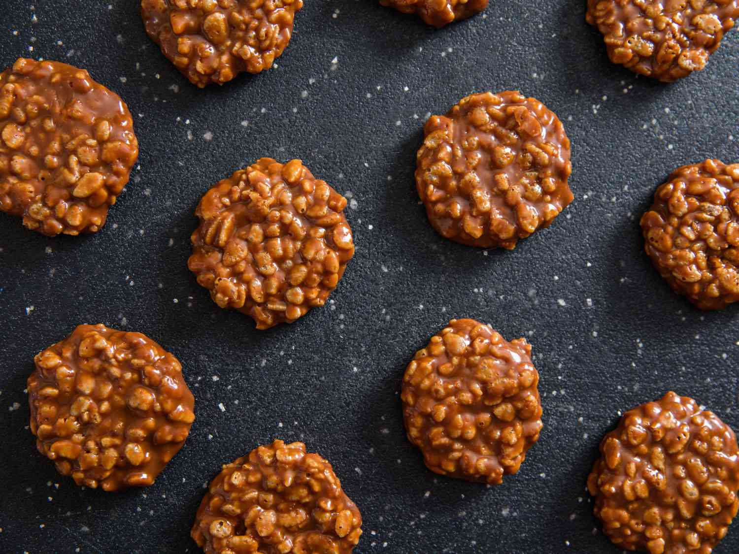 Star crunch no bake cookies on a black surface.