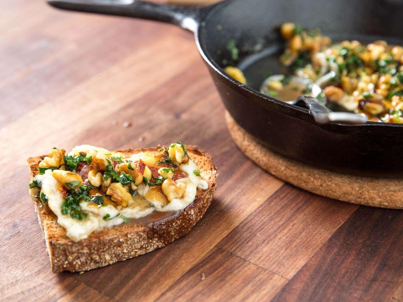 Saganaki with walnut vinaigrette on crusty bread