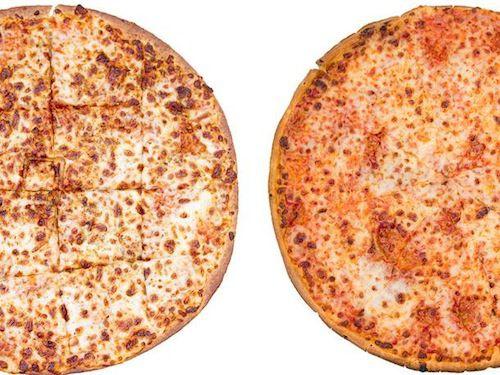 A Papa John's thin crust pizza next to a Domino's thin crust pizza.