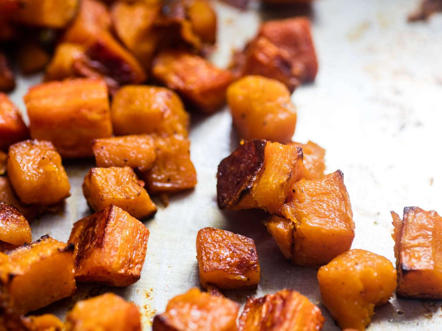 Close up of roasted squash pieces.