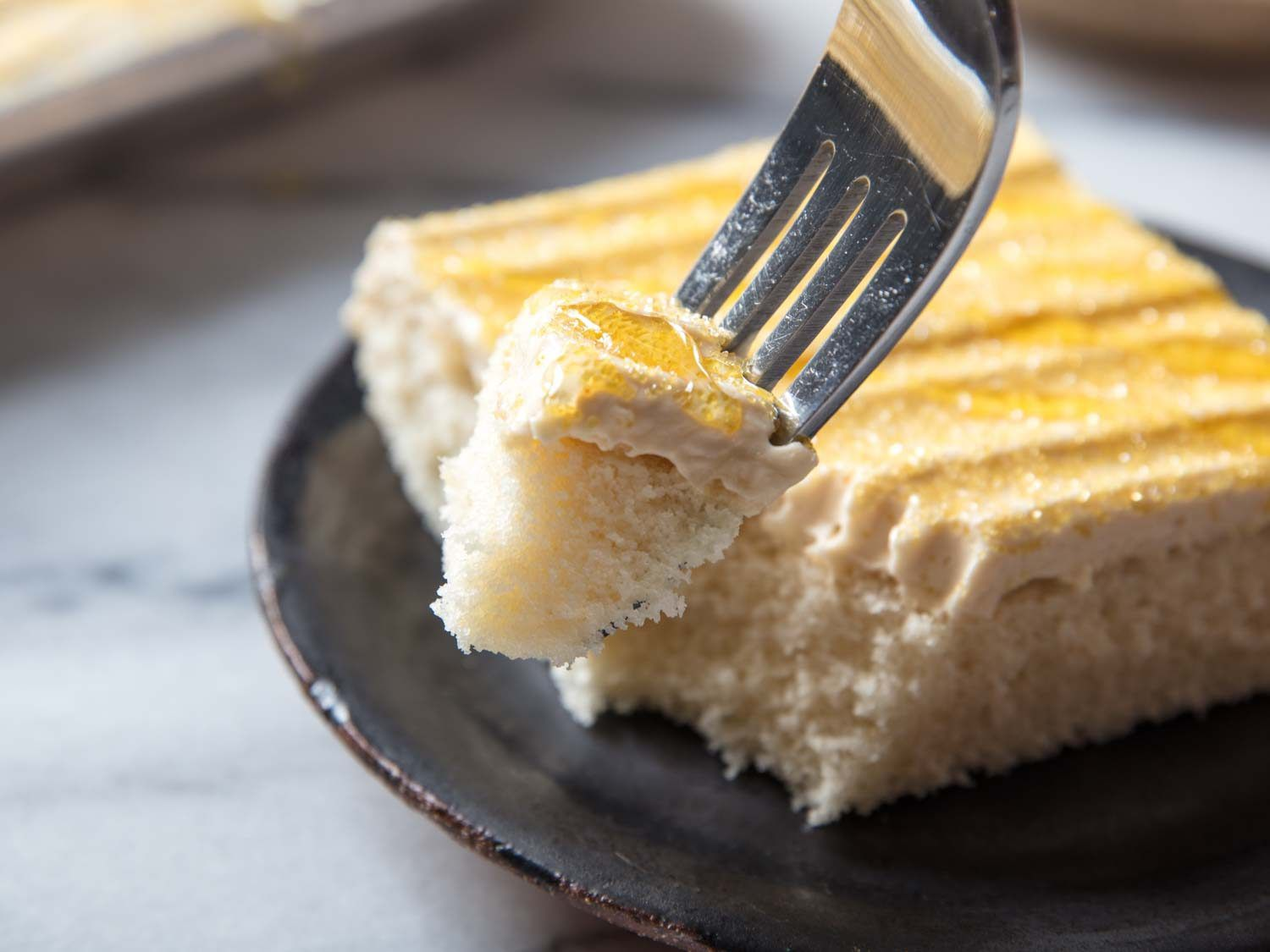 close up of cake with honey buttercream