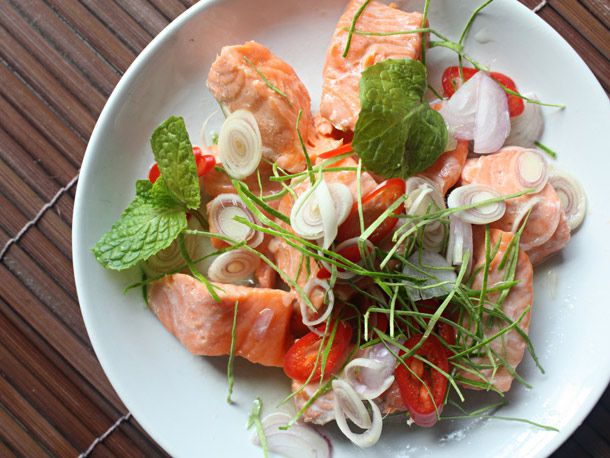 A white platter of thai herbed salmon salad.