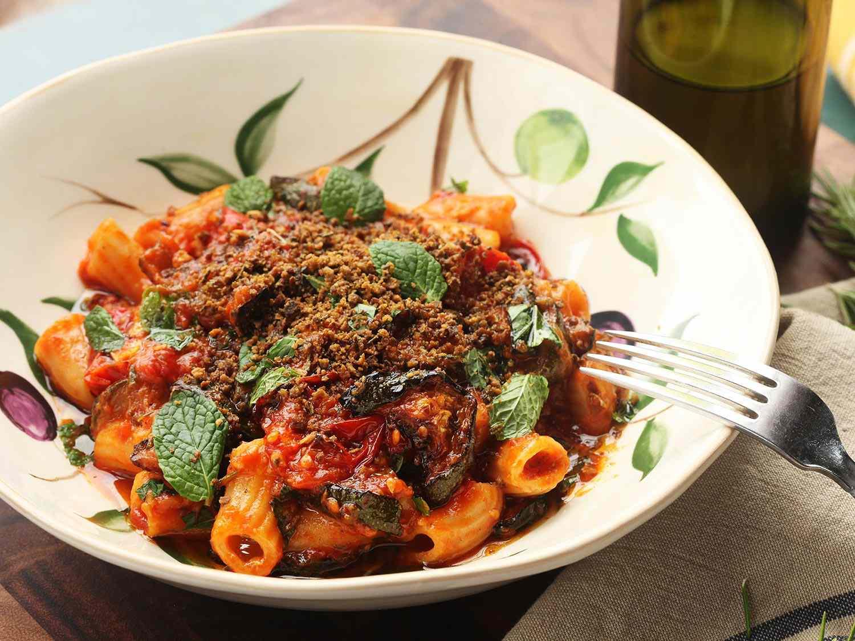 Rigatoni in tomato sauce in a white bowl.