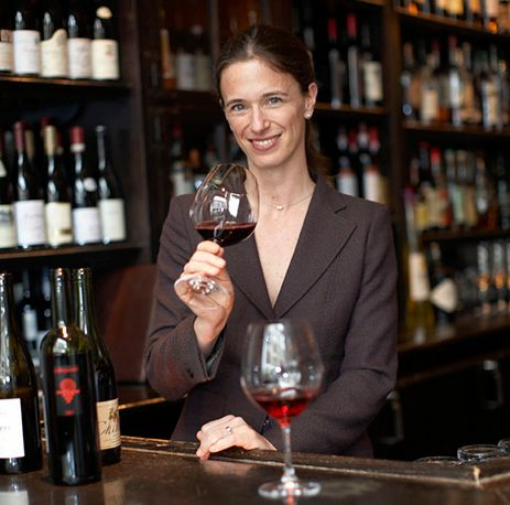 Sommelier holding a glass of red wine