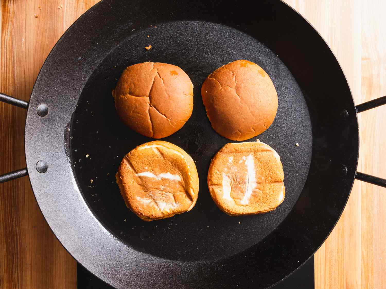 hamburger buns toasting in a skillet