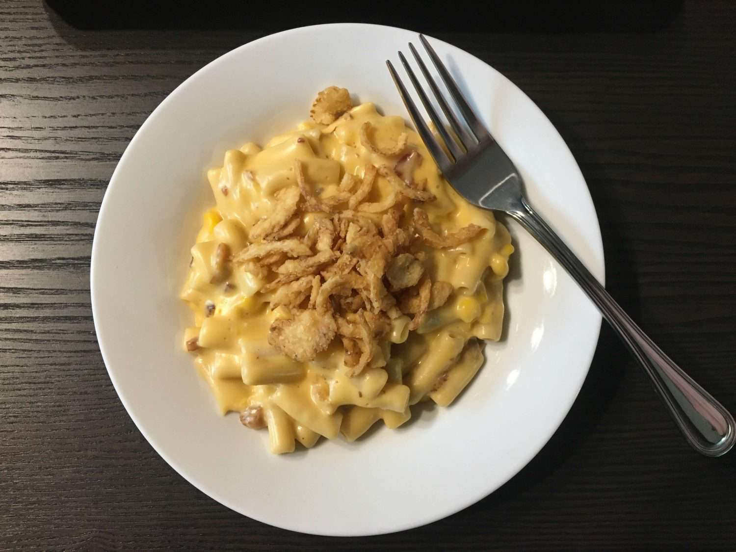 mac and cheese on a plate with fixings on top