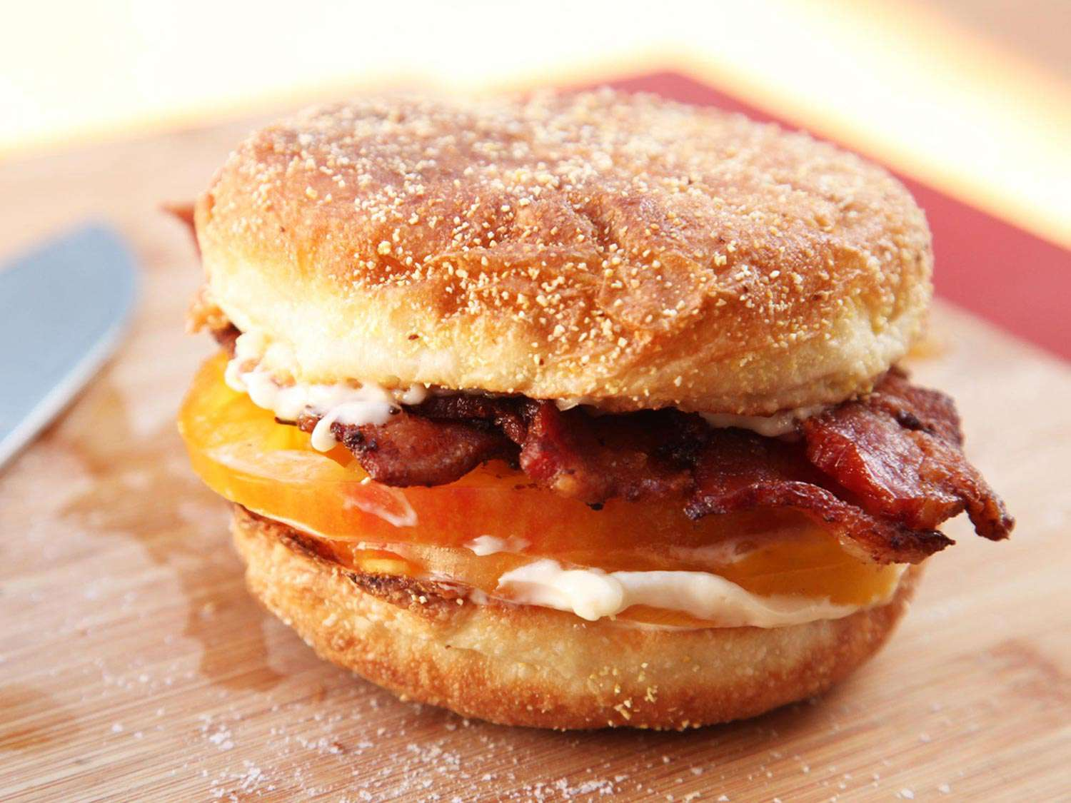 Finished bacon, mayo, and tomato sandwich on a toasted English muffin