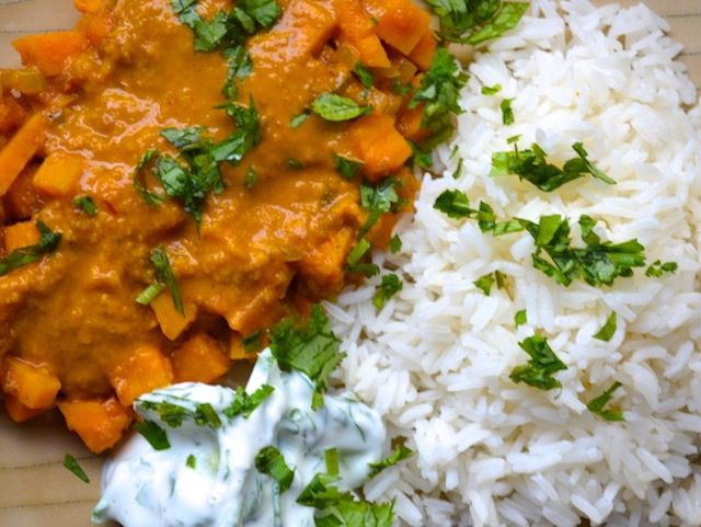 British curry sauce mixed with vegetables and served with white rice and parsley garnish
