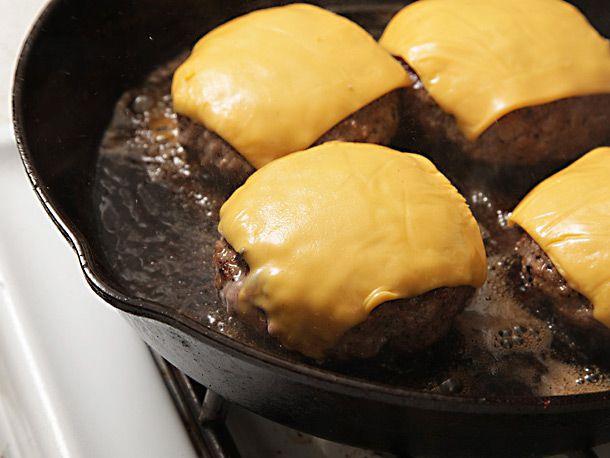 adding cheese to burger patties