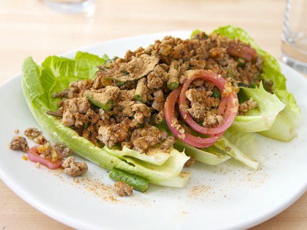 A platter of duck larb on romaine lettuce leaves.