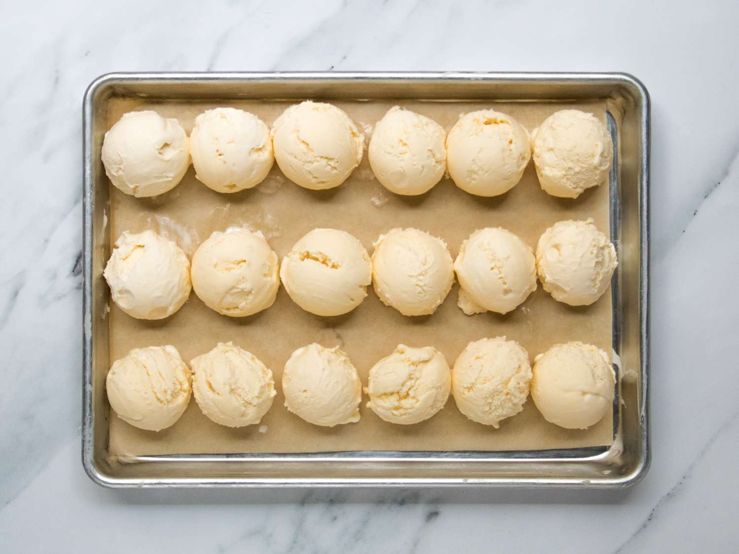 a baking sheet filled with ice cream scoops