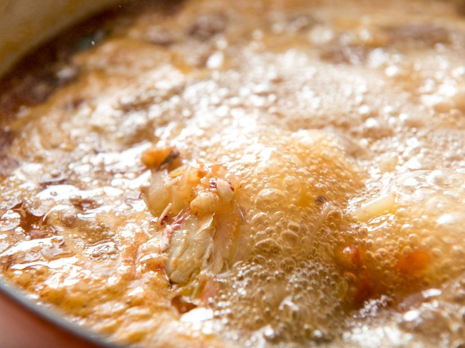 Boiling the fish stock for bouillabaisse