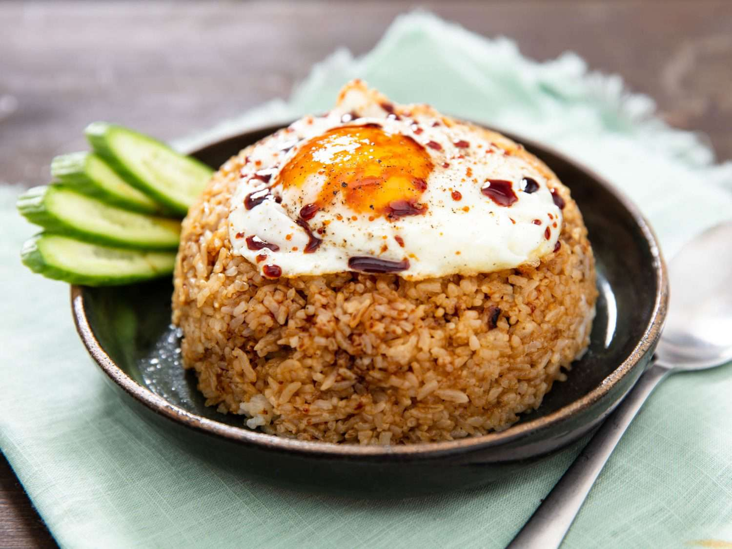 Nasi goreng on plate, topped with a fried egg