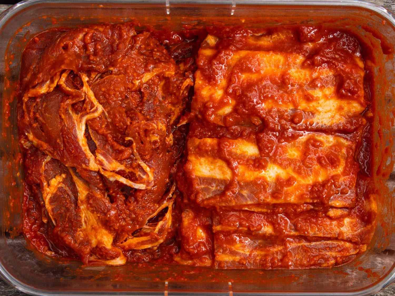 Thinly sliced pork shoulder and pieces of pork belly marinating for dwaeji bulgogi.