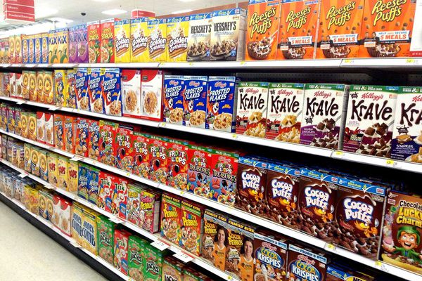 A cereal aisle in a grocery store.
