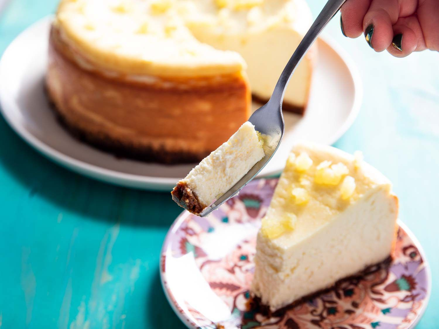 Taking a bite from a slice of lemon cheesecake
