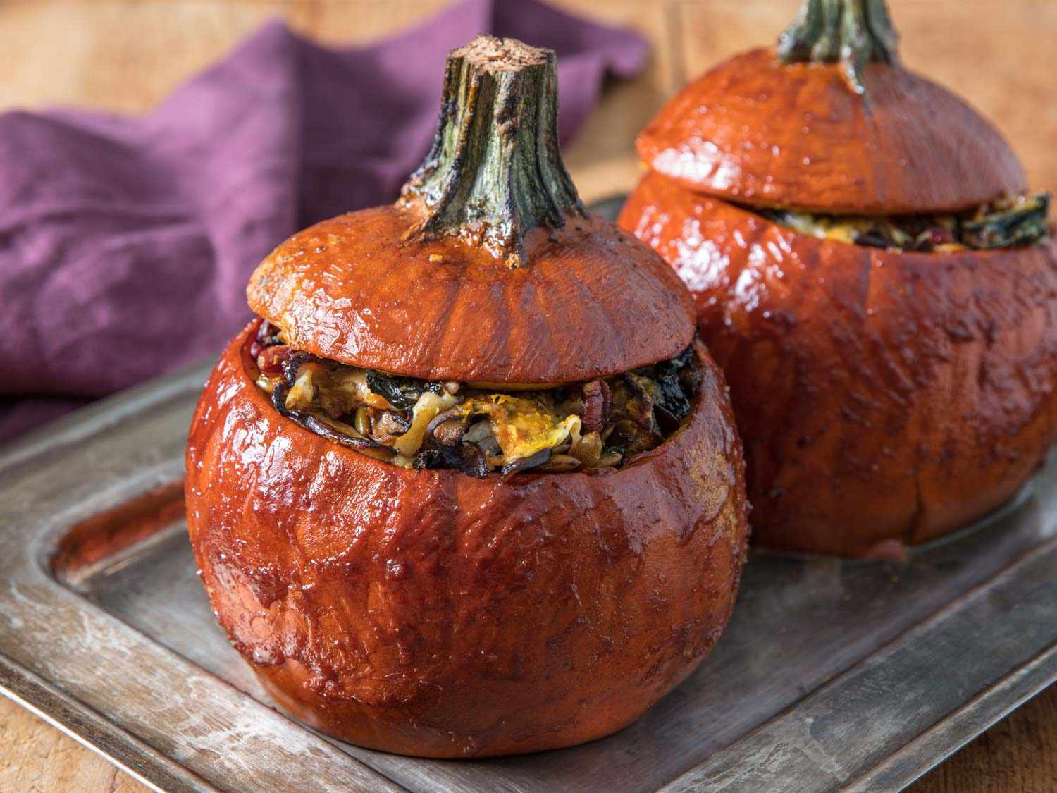 Stuffed pumpkins with Gruyere, mushrooms, kale (for Thanksgiving and holidays), glazed and tops on.