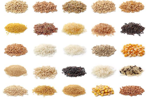 small piles of 25 different whole grains such as different rices, corn, wheat berries, millet, and others.