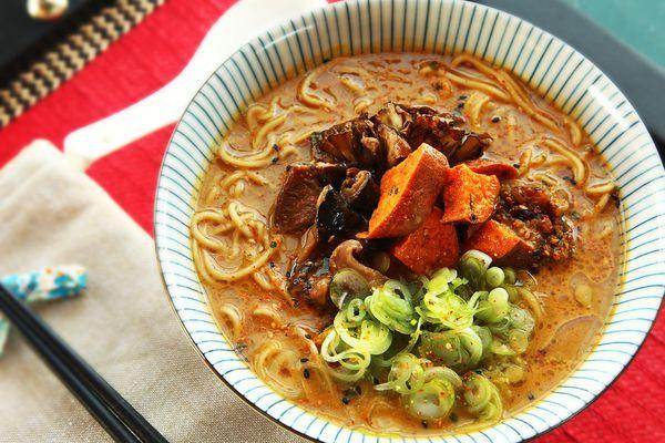 Homemade creamy vegan ramen topped with mushrooms, sweet potatoes, eggplant, and scallions.