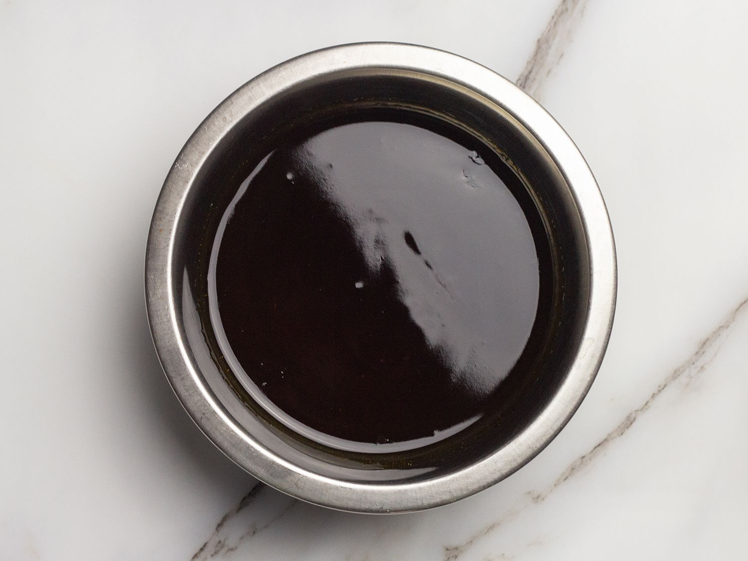 Overhead view of finished soy glaze in a small mixing bowl