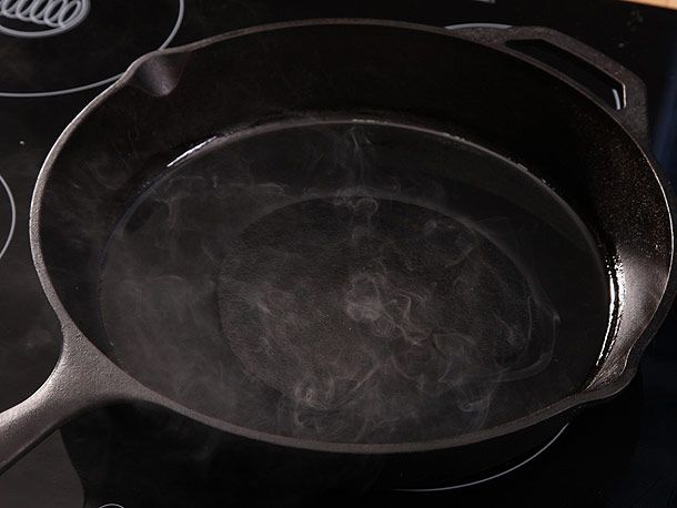 heating cast iron skillet on stovetop