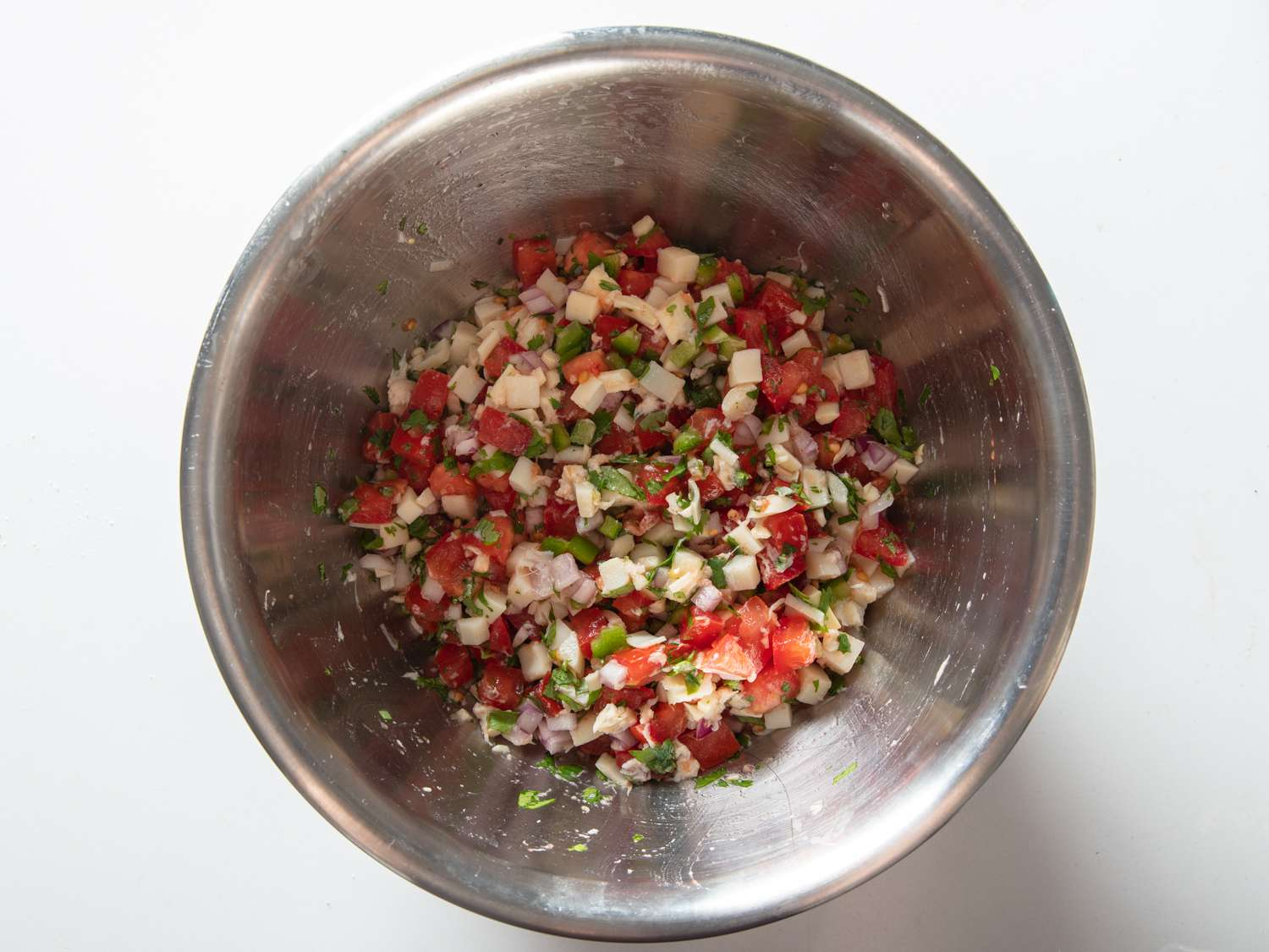 hearts of palm salsa being made in a stainless steel bowl