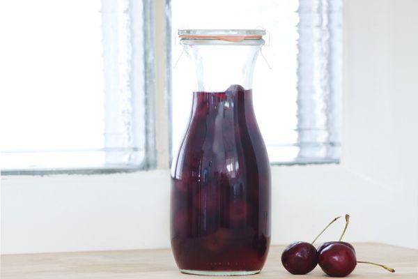 A carafe of homemade cherry liqueur