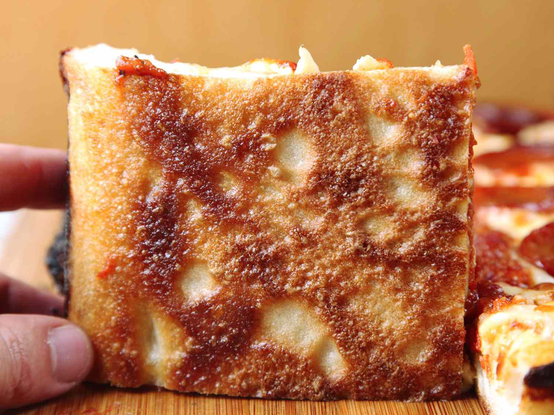 Crisp bottom of a Detroit-style pizza crust
